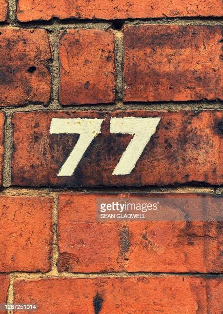 house number 77 - embellishment stock pictures, royalty-free photos & images