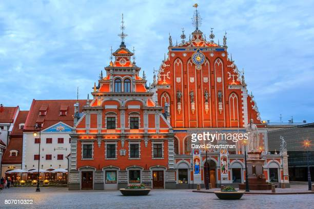 house of blackheads at dusk, riga, latvia - house of blackheads stock photos and pictures