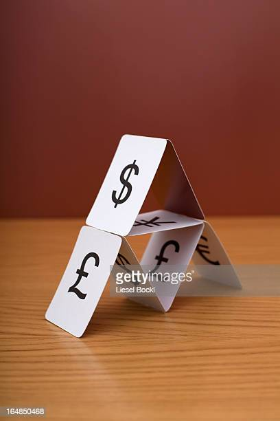 A house of cards of various currency