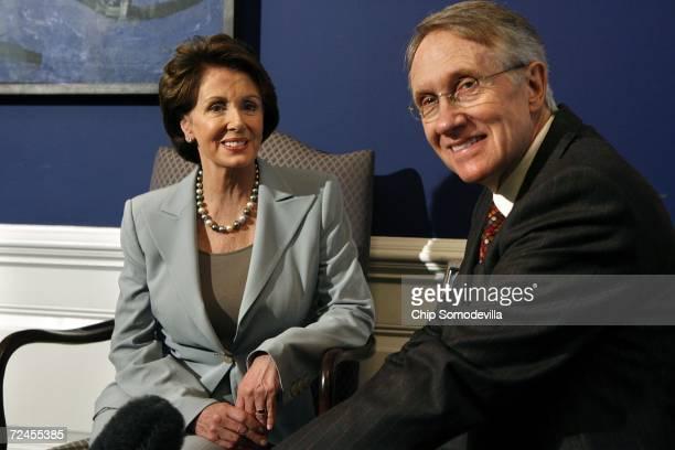 House of Representatives Democratic Leader Nancy Pelosi and Senate Democratic Leader Harry Reid pose for photographs in Pelosi's office at the US...