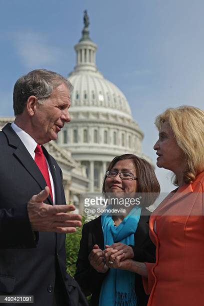 S House of Representatives Victims' Rights Caucus Chairman Rep Ted Poe and Rep Carolyn Maloney talk with human trafficking survivor Shandra Woworuntu...