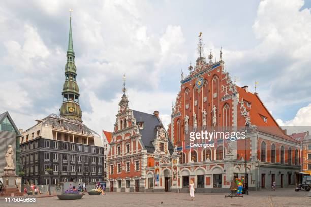 house of the blackheads & st. peter's church in riga - blackheads stock photos and pictures