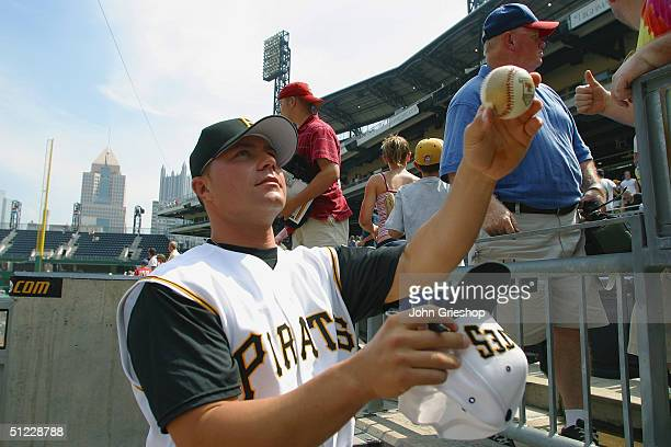R House of the Pittsburgh Pirates signs autographs before the game against the Atlanta Braves at PNC Park on July 29 2004 in Pittsburgh Pennsylvania...