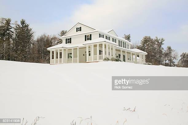 house on a hill after a winter snow - after stock photos and pictures