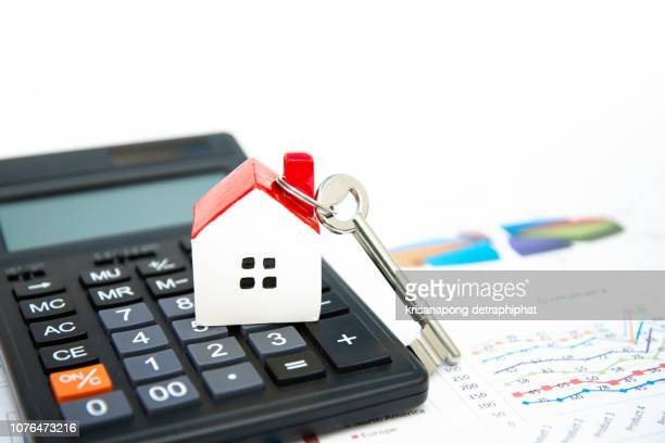 house on calculator, mortgage calculator on white background,home concept,selling home - house icon stock pictures, royalty-free photos & images