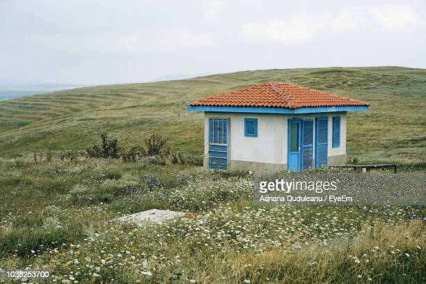 house on field against sky - adriana duduleanu stock photos and pictures