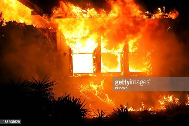 house on fire at night - burning stock photos and pictures