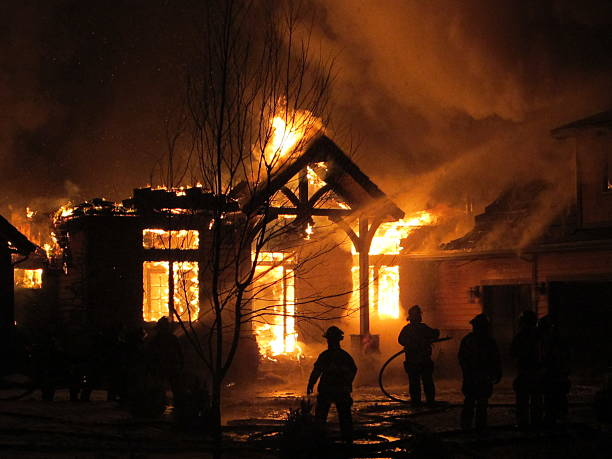 house on fire that the firemen are trying to extinguish - house stock pictures, royalty-free photos & images