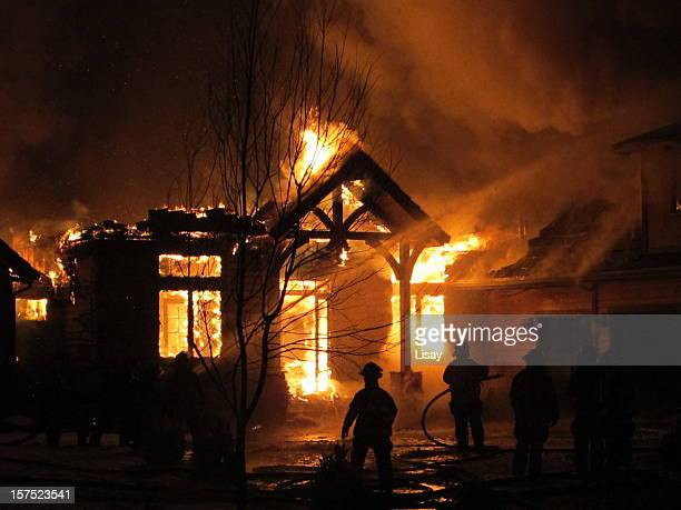 house on fire that the firemen are trying to extinguish - fire natural phenomenon stock pictures, royalty-free photos & images