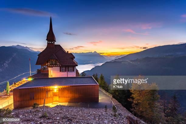 House on Harder Kulm, top aerial view of Interlaken, Switzerland at sunset time