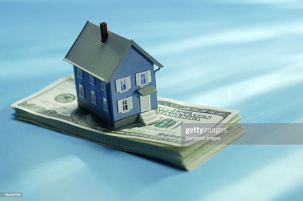 House on stack of money : Stock Photo