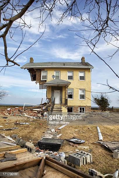 House on the waterfront known as The Princess Cottage is nearly cut in half by Hurricane Sandy. Hundreds of homes in the small town were destroyed by...