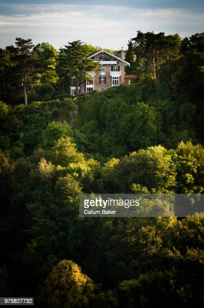 house on top of hill over lush trees, clifton, bristol, england, uk - bristol england stock pictures, royalty-free photos & images