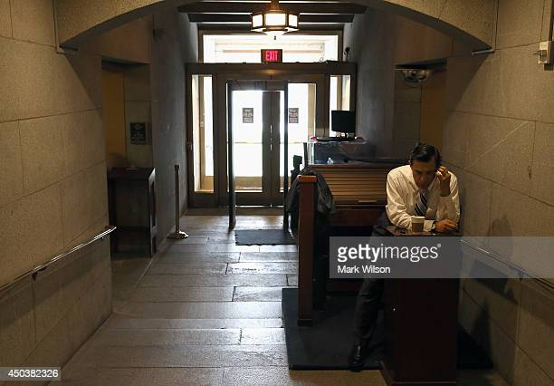 House Oversight and Government Reform Committee Chairman Darrell Issa talks on his phone at a closed entrance to the US Capitol June 10 2014 in...