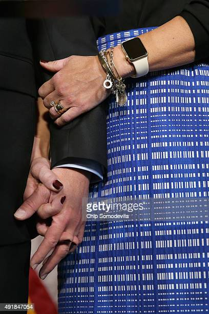 House Oversight and Government Reform Committee Chairman Jason Chaffetz holds hands with his wife Julie Chaffetz as he confirms that he will continue...