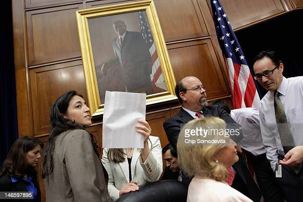 House Oversight and Government Reform Committee Chief Counsel Susanne Sachsman Grooms and other staff members attempt to keep the news media from...