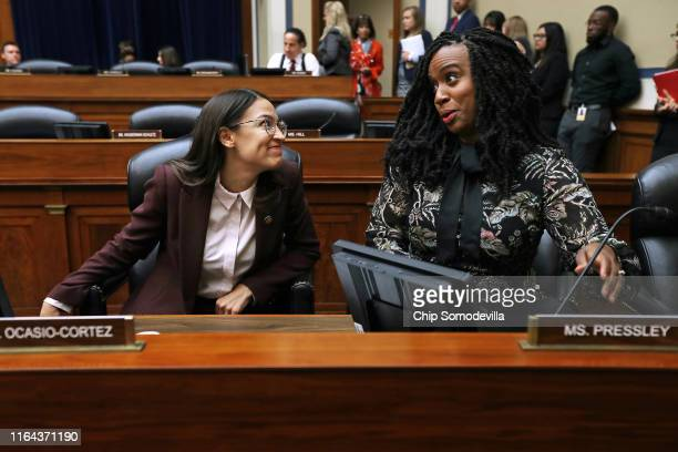 House Oversight and Government Reform Committee members Rep Alexandria OcasioCortez and Rep Ayanna Pressley talk before a hearing on drug pricing in...