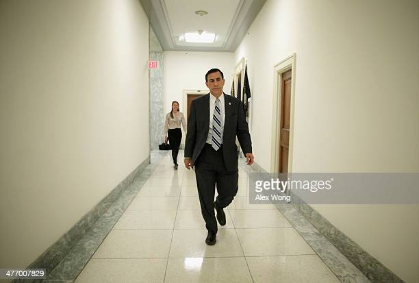 S House Oversight Government Reform Committee Chairman Rep Darrel Issa returns to his office after votes on the House floor March 6 2014 on Capitol...