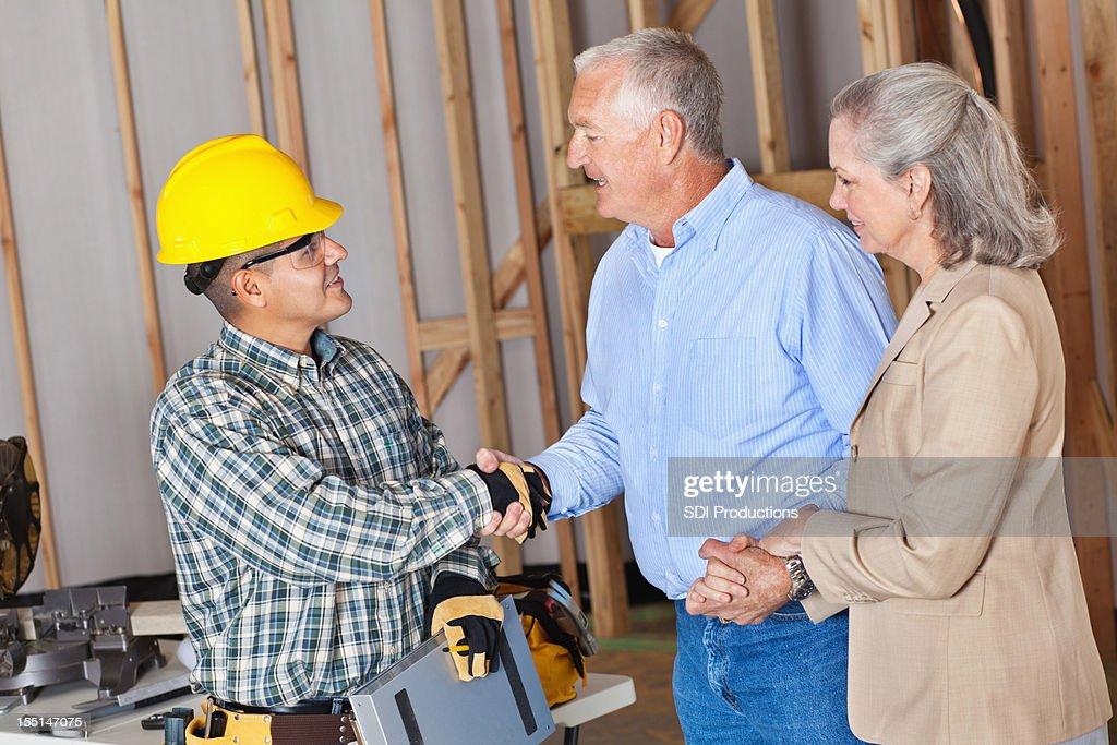 House owners greeting building contractor : Stock Photo