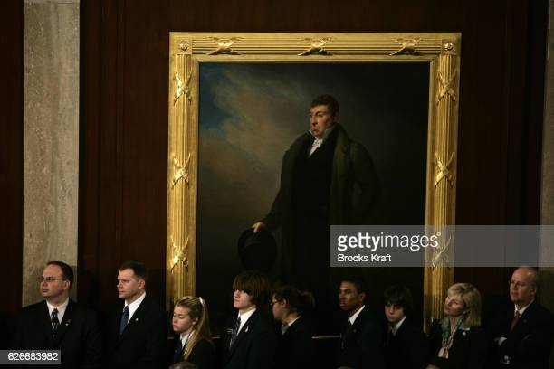 House pages and White House Deputy Chief of Staff Karl Rove look on as President George W Bush delivers his State of the Union speech to a joint...