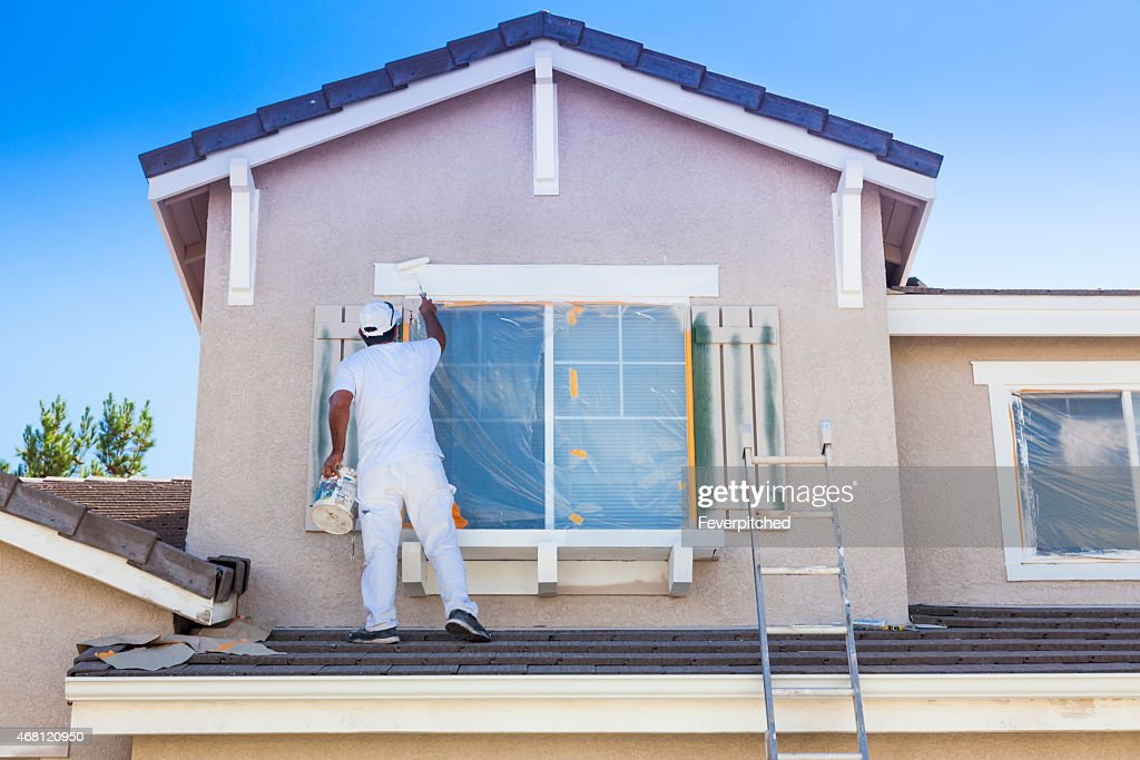 Modern Interior; House Painter Painting The Trim And Shutters Of Home ...