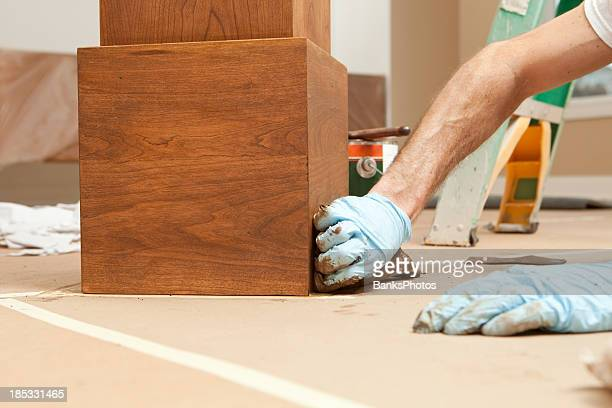 House Painter Staining a Cherry Column