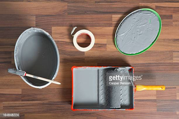 House painting equipment on a hardwood floor