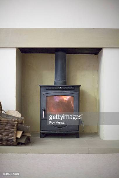 house - wood burning stove stock photos and pictures