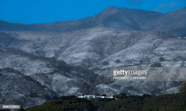 A house remains standing in front of an ashfilled hillside from recent fires in Montecito California on December 20 amid concerns the return of winds...