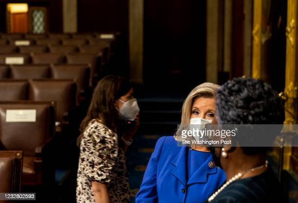 House Republican Conference chairwoman Representative Liz Cheney speaks to a Capitol Hill staffer on the House Floor before President Joe Biden...