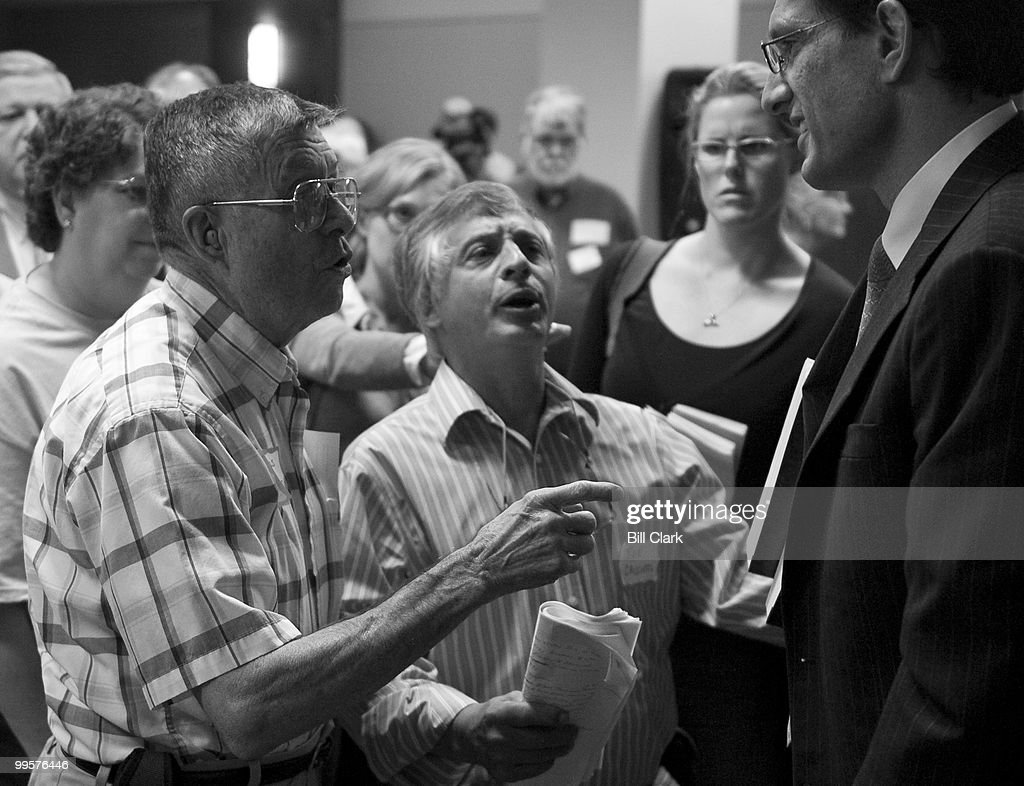 House Republican Whip Eric Cantor, R-Va., right, hears from some angry constituents following the 'Public Square' event Rep. Bobby Scott, D-Va., on health care reform, hosted by the Richmond Times Dispatch in Richmond, Va., on Monday morning, Sept. 21, 2009.