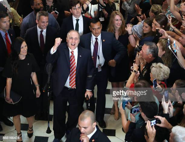 House Republican Whip Steve Scalise reacts to cheers as he returned to the Capitol Hill for the first time after being shot in June at a...