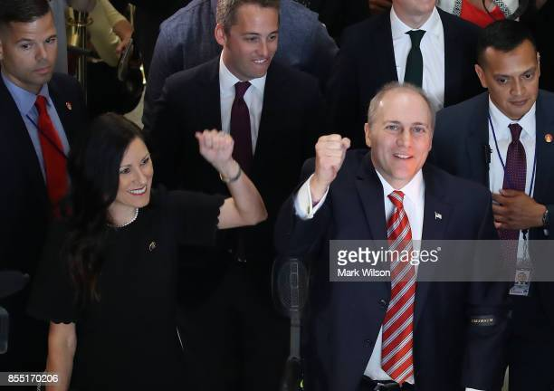 House Republican Whip Steve Scalise stands with his wife Jennifer as he reacts to cheers after returning to the Capitol Hill for the first time after...