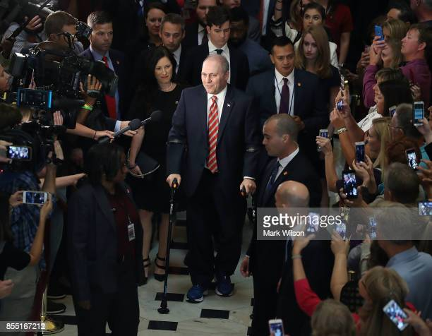 House Republican Whip Steve Scalise uses crutches after returning to the Capitol Hill for the first time after being shot in June at a congressional...