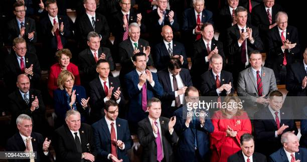 House Republicans stand and applaud during President Donald Trump's State of the Union Address to a joint session of Congress in the Capitol on...