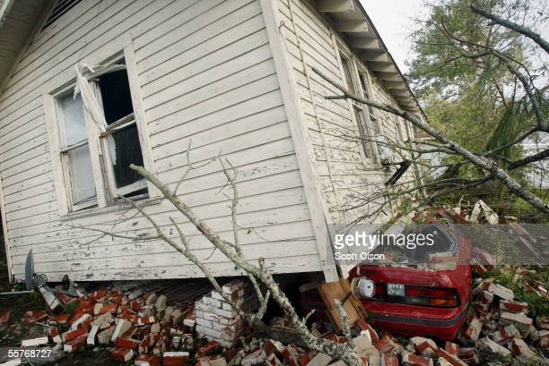 A house rest atop a car following Hurricane Rita September 25 2005 in Lake Charles Louisiana Rita hit land as a category 3 hurricane near the...