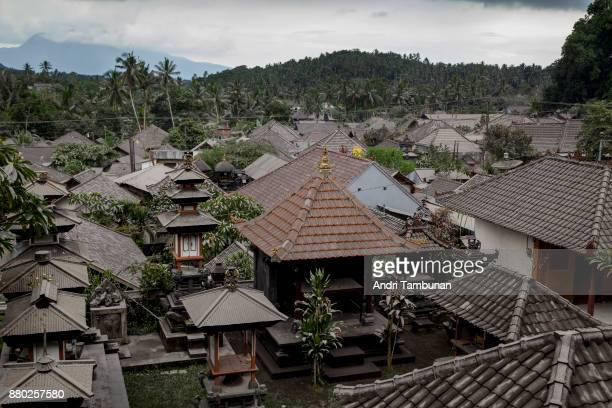 KARANGASEM BALI INDONESIA NOVEMBER 27 House roofs at Sibetan village are seen covered by a layer of ash spewed by Mount Agung eruption on November 27...