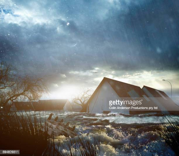 house roofs in flood - torrential rain stock pictures, royalty-free photos & images