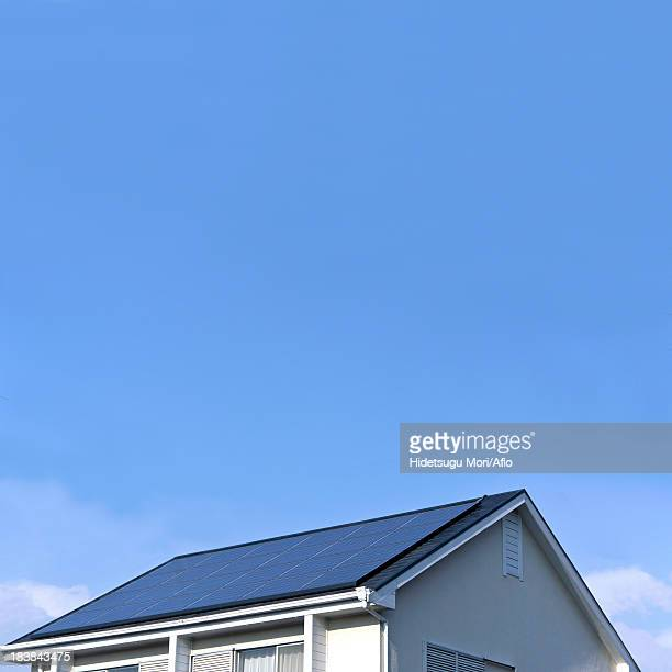 House rooftop with solar panel