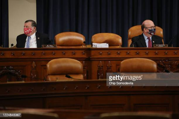 House Rules Committee Chairman Jim McGovern and ranking member Rep. Tom Cole wear face masks during a hearing about the proposal to authorize remote...
