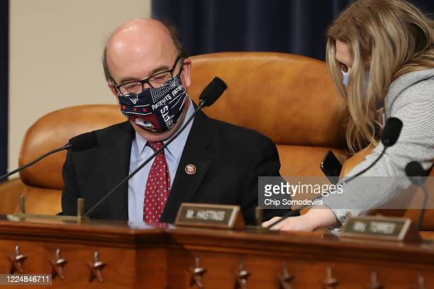 House Rules Committee Chairman Jim McGovern wears a New England Patriots-themed face mask during a hearing about the proposal to authorize remote...