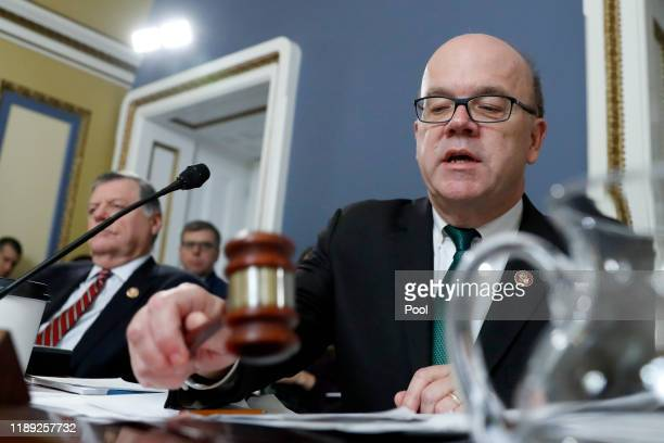 House Rules Committee chairman Rep. Jim McGovern bangs the gavel for a recess during a House Rules Committee hearing on the impeachment against...