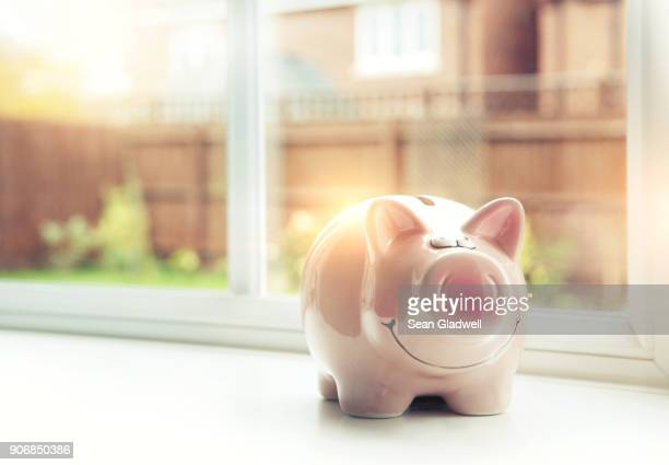 house savings - piggy bank stock photos and pictures