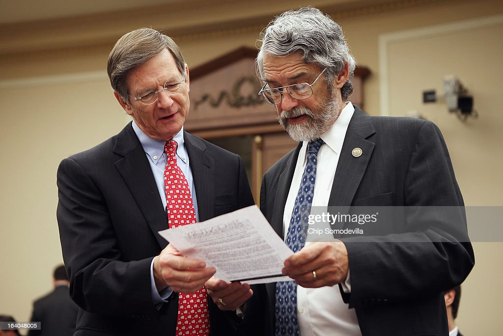House Science, Space and Technology Committee Chairman Lamar Smith (R-TX) (L) looks over some data with White House Office of Science and Technology Policy Director John Holdren before a hearing in the Rayburn House Office Building on Capitol Hill March 19, 2013 in Washington, DC. The committee asked government and military experts about efforts to track and mitigate asteroids, meteors and other 'near-Earth objects.'