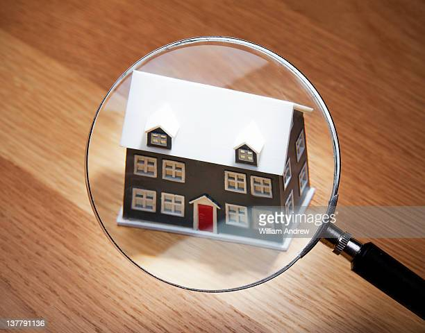 House scrutinized by magnifying glass