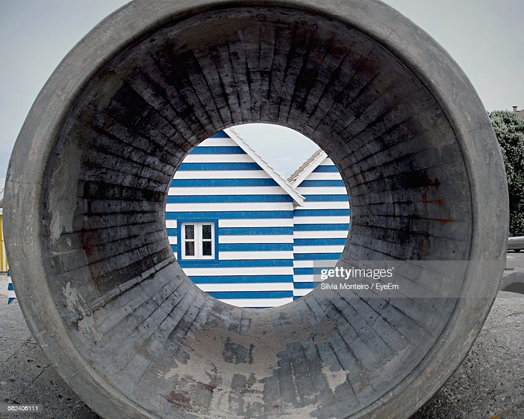 House Seen Through Concrete Pipe On Site Stock Photo - Getty