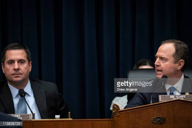 US House Select Committee on Intelligence ranking member Devin Nunes looks on as committee Chairman Adam Schiff responds to Republican calls for him...
