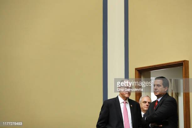 House Select Committee on Intelligence ranking member Rep Devin Nunes and member Rep Mike Conaway wait by the hearing room door for the end of a...