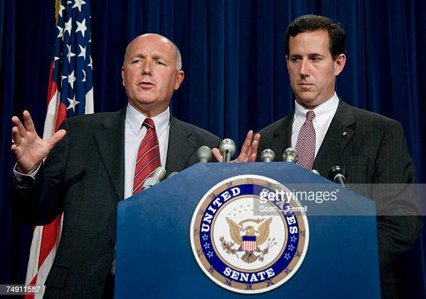 House Select Intelligence Chairman Peter Hoekstra RMich and Sen Rick Santorum RPa during a news conference releasing declassified information from a...