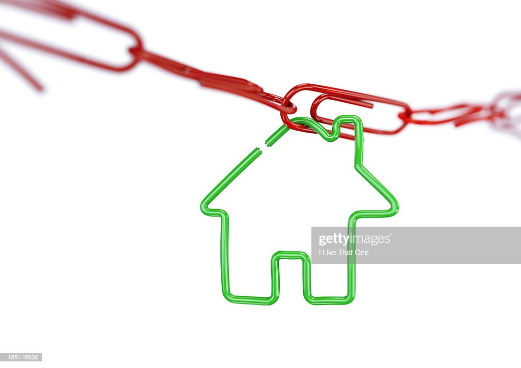 House shape attached to a paperclip chain : Stock Photo